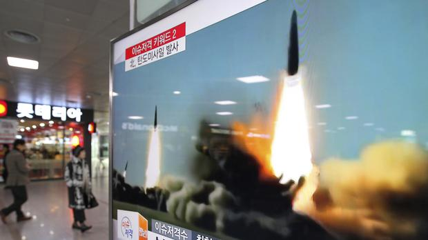 A TV at Seoul station shows footage of a North Korean missile launch (AP)