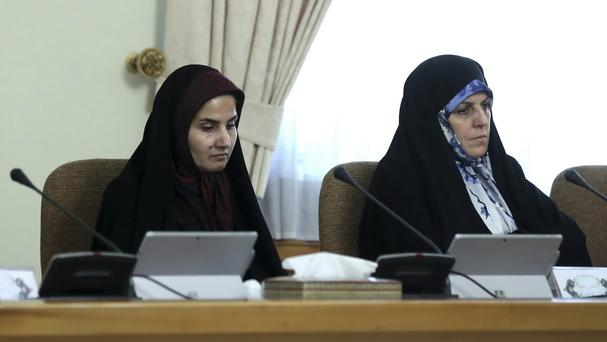 Laaya Joneidi, left, and assistant to the president on citizenship rights, Shahindokht Molaverdi, right, attend a cabinet meeting (Iranian Presidency Office via AP)