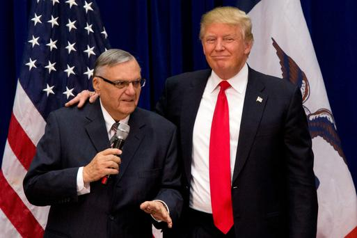 No remorse: US President Donald Trump and Joe Arpaio, whom he pardoned last week. Arapio had been found guilty of criminal contempt for illegally profile Latinos living in Arizona Photo: PA
