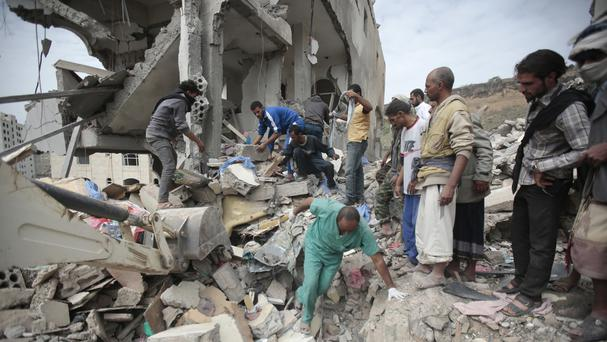 The rubble of houses destroyed by Saudi-led air strikes in Sanaa, Yemen (AP)