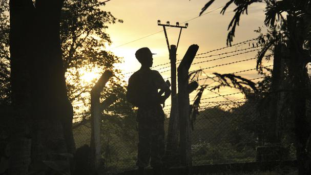 A border patrol at a police post that was attacked by a Muslim group in Myanmar (AP)