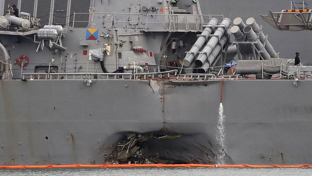 The damaged port aft hull of the USS John S McCain (AP)