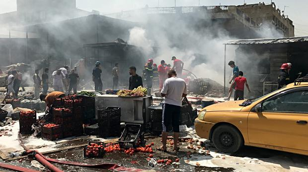 The scene of a car bomb blast in a Baghdad market (AP/Ali Abdul Hassan)