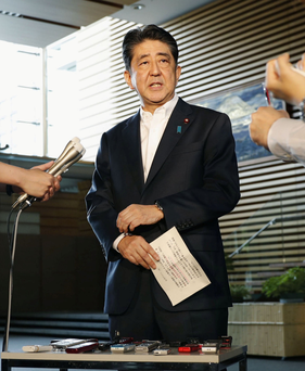 Japanese Prime Minister Shinzo Abe speaks to reporters in Tokyo about North Korea's missile launch. Photo: Kyodo/via Reuters