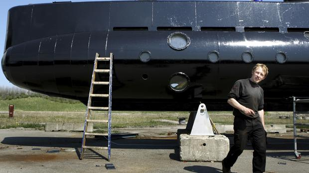 Danish inventor Peter Madsen with his home-made submarine (Niels Hougaard /Ritzau via AP, File)