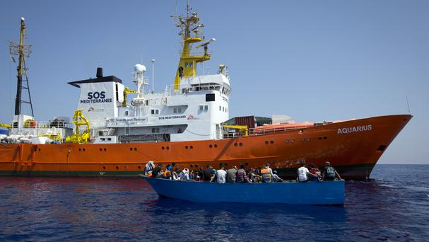 African migrants next to a rescue ship during a search operation north of the Libyan coast (AP)