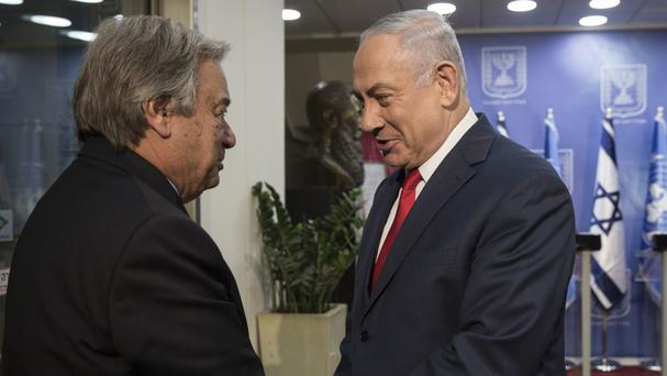 Prime Minister Benjamin Netanyahu, right, greets UN Secretary-General Antonio Guterres (Heidi Levine, Pool via AP)