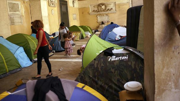 Children play around tents under the portico of the Roman Catholic Basilica of the Twelve Holy Apostles in Rome (AP/Andrew Medichini)