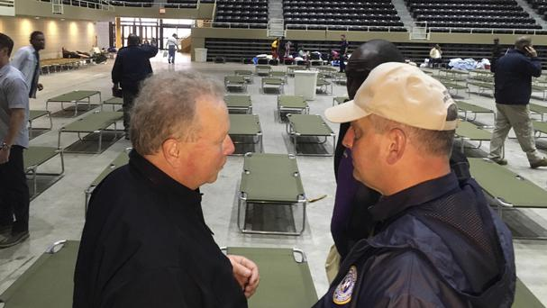 Homeland Security official Dick Gremillion and Louisiana governor John Bel Edwards at the Lake Charles Civic Centre shelter (AP)