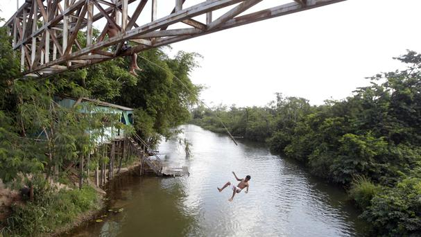 The order came under fire from environmental groups who argued it could cause environmental damage and create conflicts between miners and indigenous groups in the Amazon (AP/Andre Penner)