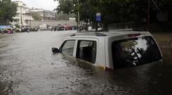 Heavy rain has brought chaos to huge areas of Mumbai (AP)