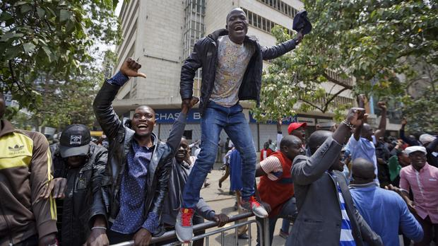Supporters of opposition leader Raila Odinga celebrate after hearing the verdict (Ben Curtis/AP)