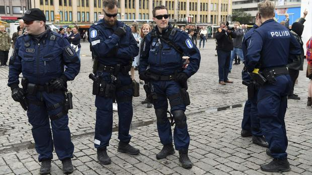 Police at Turku Market Square in Finland after a deadly stabbing attack (Vesa Moilanen/Lehtikuva via AP)
