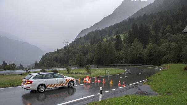 The road is closed between Casaccia and Vicosoprano (Giancarlo Cattaneo/Keystone via AP)