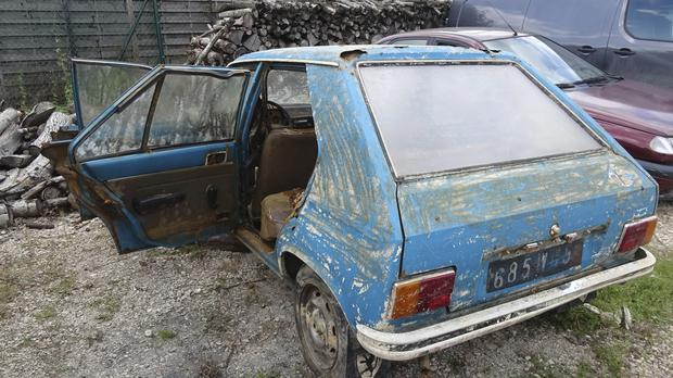 A Peugeot 104, which was recovered this week 38 years after it was stolen, is stored in a garage in Chalons-en-Champagne, eastern France (Chris den Hond/AP)