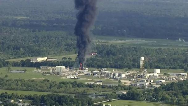 Smoke rises from the flooded Arkema chemical plant in Crosby, near Houston (KTRK via AP)