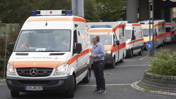 Emergency services staff evacuate patients from the Bruederkrankenhaus hospital in Koblenz, ahead of the bomb disposal operation (AP)