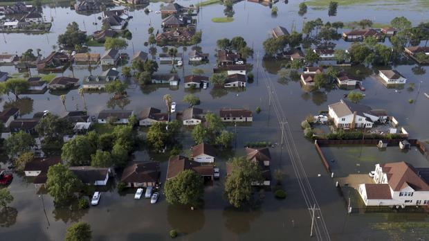 Homes in floodwaters caused Hurricane Harvey in Port Arthur, Texas (AP Photo/LM Otero)