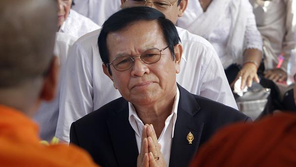 Kem Sokha prays during a Buddhist ceremony to mark the 20th anniversary of an attack on anti-government protesters in 1997, in Phnom Penh (AP Photo/Heng Sinith, File)