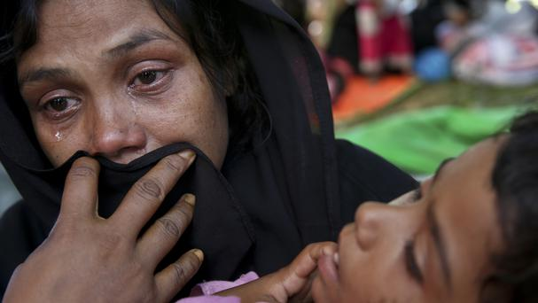 A Rohingya woman cries after being stopped by Bangladeshi border guards at a makeshift shelter at Ghumdhum, Cox's Bazar, Bangladesh (AP)