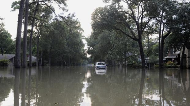 A pick-up truck stranded in a flooded street in Houston, Texas (AP Photo/Jay Reeves)