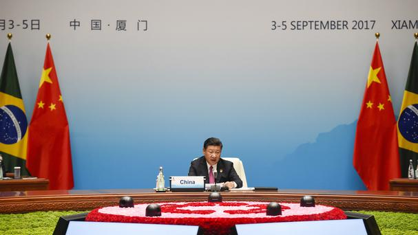 Chinese president Xi Jinping speaks at the plenary session of the Brics summit in Xiamen, Fujian province (AP)