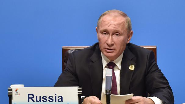 Mr Putin said it would be inappropriate to discuss domestic American politics (AP)
