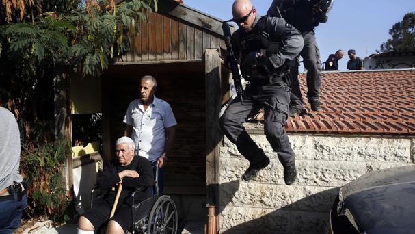 Israeli police remove the Palestinian family from their home in east Jerusalem (AP)