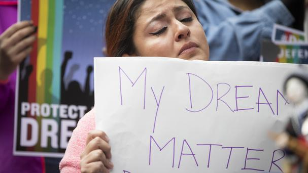 Evelin Hernandez makes her point at a protest in Minneapolis (Star Tribune/AP)