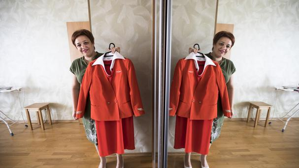 Aeroflot flight attendant Yevgeniya Magurina shows her uniform