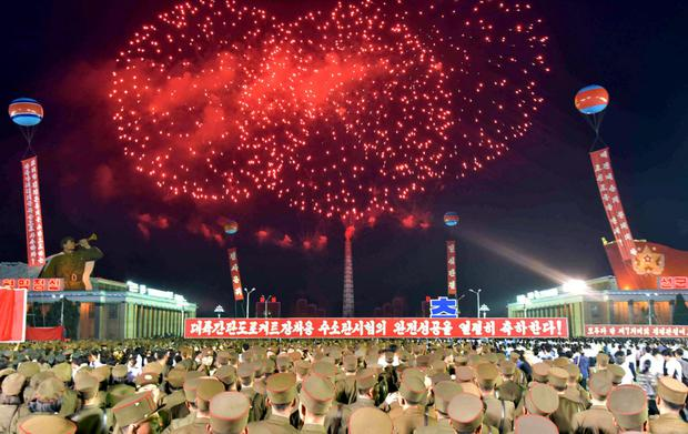 An undated photo released by North Korea's Korean Central News Agency yesterday showing celebrations in Pyongyang marking the completion of the hydrostatic test for the intercontinental ballistic rocket installation. Photo: REUTERS