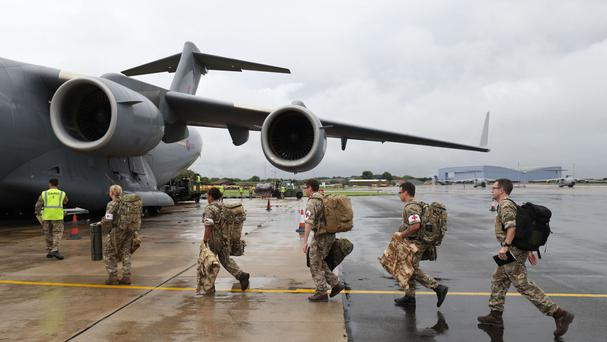 Soldiers board a Royal Air Force C-17 Globemaster III aircraft at Brize Norton, Oxfordshire, before they are flown to help out in the areas hit by Hurricane Irma