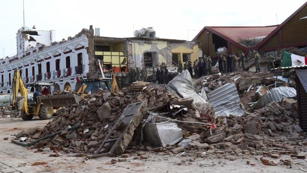 Soldiers remove debris from a partly collapsed municipal building in Juchitan, Oaxaca state (AP)