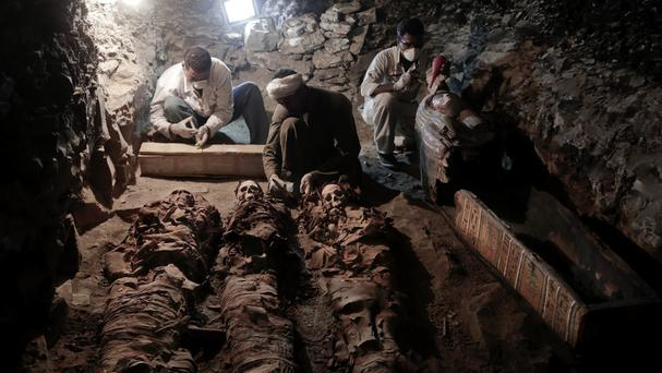 Archaeologists work on mummies found in the tomb in Luxor (AP/Nariman El-Mofty)