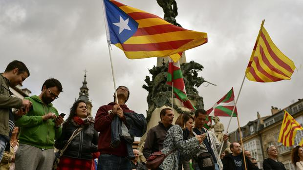 Pro-independence supporters wave
