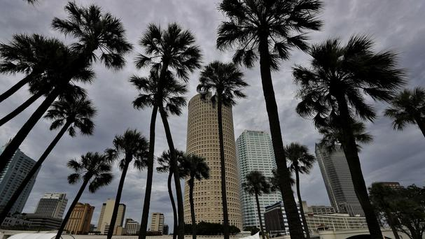 Storm clouds associated with the outer bands of Hurricane Irma shroud the Tampa, Florida, skyline (AP)