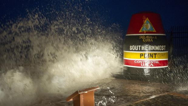 Waves crash against the Southernmost Point in Key West, Florida (The Key West Citizen/AP)