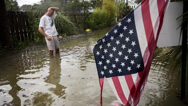 Tybee Island resident Joe Murphy standing in knee deep water from Tropical Storm Irma outside his house in Georgia (AP)
