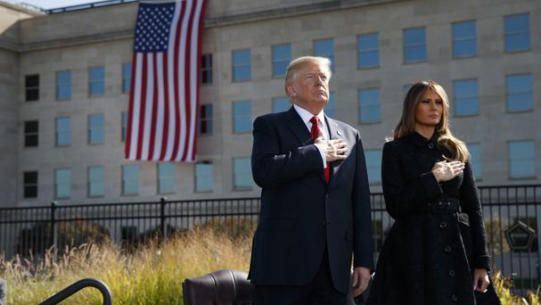 President Donald Trump and first lady Melania Trump mark the anniversary of the September 11 terrorist attacks at the Pentagon (Evan Vucci/AP)
