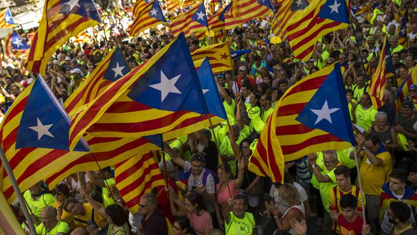 Pro-independence campaigners during Catalan national day in Barcelona (AP)