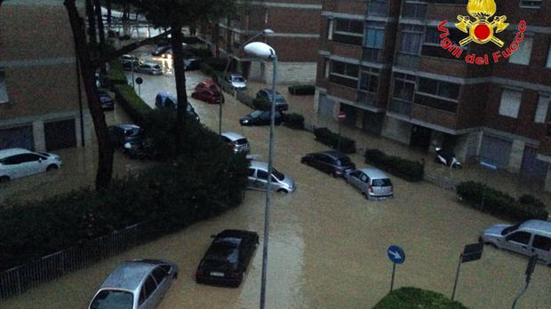 Cars in the city of Leghorn, Italy, after major flooding (Vigili del Fuoco/AP)