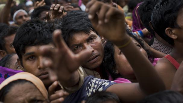 Rohingya ethnic minority refugees reach for food distributed by Bangladeshi volunteers near Cox's Bazar's Gundum area, Bangladesh (AP)