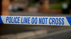 Police were called at 10am and sealed off the area surrounding his mother's flat. Stock image