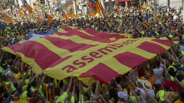 Hundreds of thousands of Catalans marked their national holiday on Monday by supporting the right to vote on independence (AP)