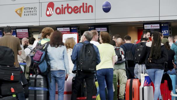 Travellers at the Air Berlin desk at Dusseldorf Airport (dpa/AP)