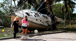 A boat washed ashore at the Dinner Key marina. Photo: Getty Images