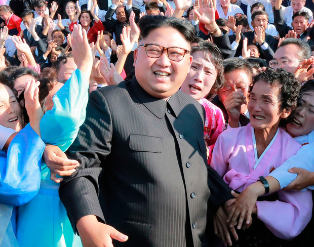 North Korea leader Kim Jong-un meets supporters yesterday