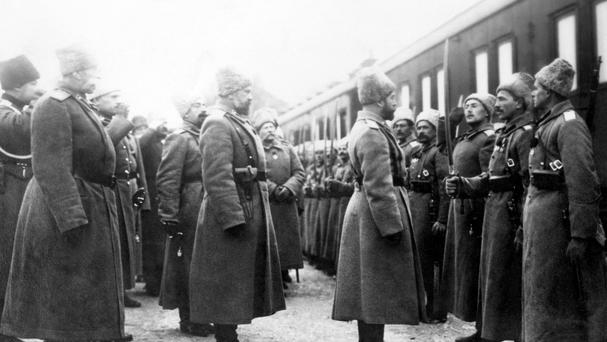 Tsar Nicholas II of Russia inspects a Cossack guard of honour