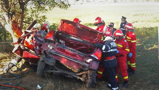 The scene of an accident in northern Romania where a car carrying British charity volunteers crashed, killing the driver and injuring three passengers (Bistrita Nasaud County Emergency Services/AP)