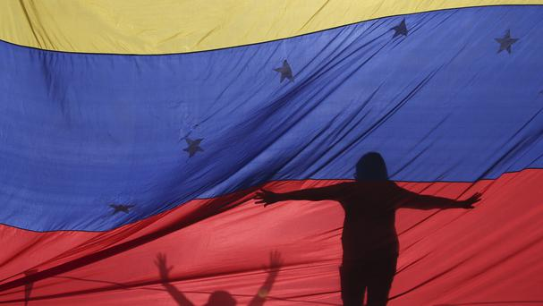 Venezuela's government and opposition are advancing in exploratory talks aimed at creating a framework to resolve the nation's economic and political crisis (AP)